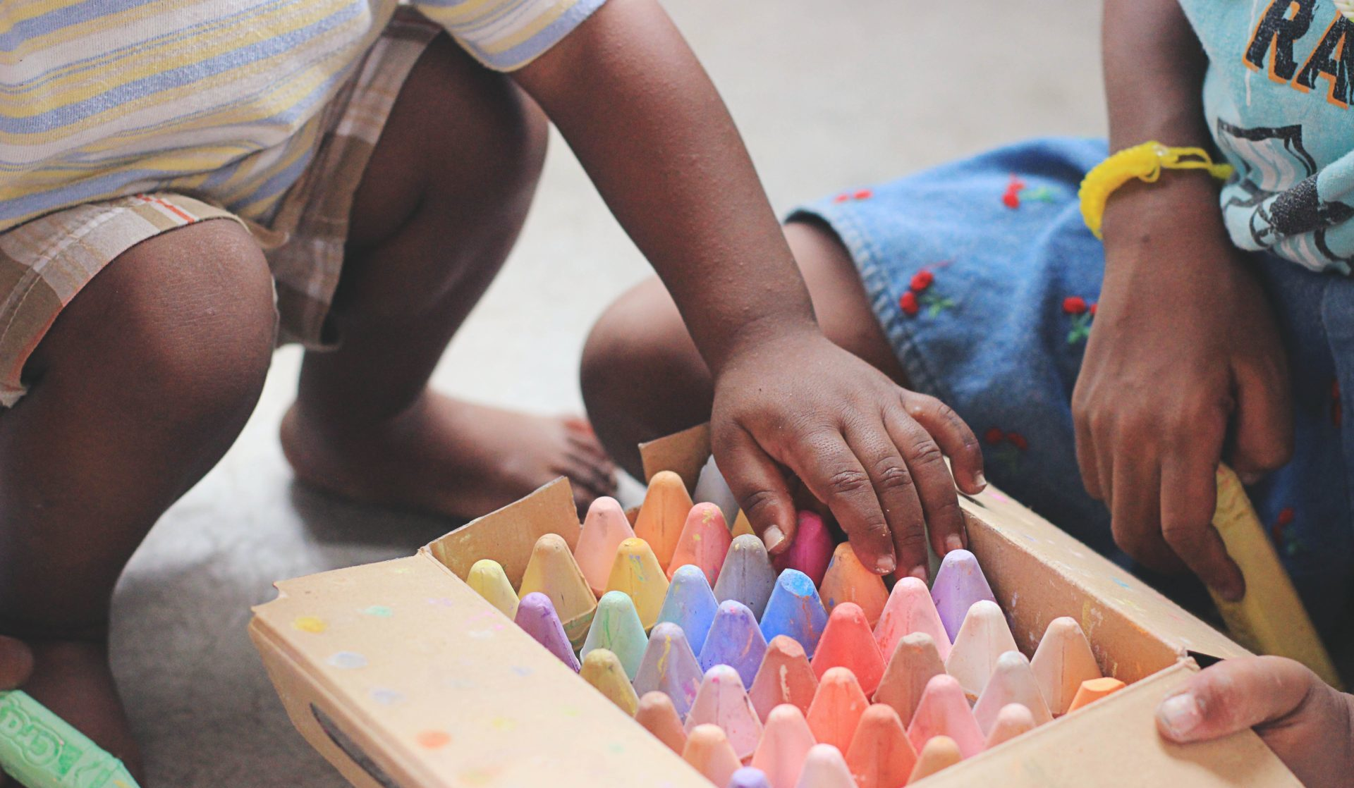 Children in Haiti using chalk